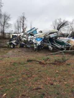 Boats piled up after the tornado at DSA.